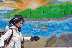 Woman with Mural (fotofrysk) Tags: blue woman toronto ontario canada green mural pedestrian wintercoat gloves queenstreet the earwarmers d7100 beachesnikon