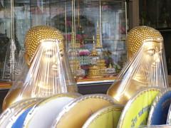 Bangkok market - Buddhas under wrap - Thailand (ashabot) Tags: street art thailand seasia cities statues buddhism citystreets streetscenes marketscenes