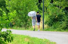 passeggiata con ombrello (M a r i S ) Tags: street people green umbrella parasol ombrello passeggiata parasole attheback