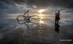 REFLECTION CATCHER... (segokavi) Tags: boat sunrise reflection sanur bali sea beach morning landscape water pantaikarang seascape photographer