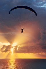 Parapente (Mikel Martnez de Osaba) Tags: blue sunset sea sky orange cloud sun sunlight silhouette sport yellow sunrise freedom fly ray risk wind action dusk vibrant air extreme flight wing free vivid beam adventure colourful paragliding gliding glider paraglider parachute glide