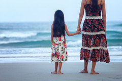 Rear view of a mother and daughter standing on the beach (Patrick Foto ;)) Tags: family blue sea summer vacation two people woman sun holiday love beach nature girl look smiling modern female children mom asian fun thailand outdoors happy person back kid healthy sand holding child play hand view bright little walk background joy daughter mother lifestyle happiness front human barefoot blonde concept active strolling
