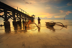PANTAI PASIR PUTIH (ManButur PHOTOGRAPHY) Tags: ocean travel sunset sea wild sky cloud sun white seascape man west beach water clouds self canon indonesia photography eos fisherman dock scenery colorful exposure ship glow village waterfront view explorer east explore human filter shore 7d usm tradition dslr filters efs 1022mm poeple waterscape whitesandbeach eastasia colourfull canonefs1022mmf3545usm eastjava pasirputih gnd f3545 sillhuette sillhuet canon7d easasia manbutur manbuturphotography