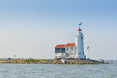 Marker Lighthouse (roevin | Urban Capture) Tags: blue light sea summer sky people sun lighthouse white house lake tower water construction offshore thenetherlands visit land dyke current marken currents paardvanmarken
