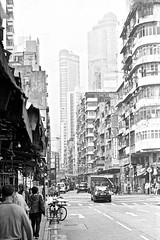 Reclamation St. (*Julius*) Tags: life china street city bw hk white black building film 35mm buildings asian hongkong living asia fuji south east busy 400 fujifilm neopan 135 arcitecture expired crowded