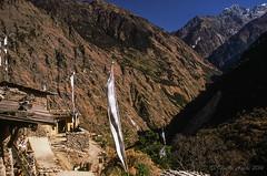 Syabru, Nepal, 1988 (NettyA) Tags: travel nepal houses mountains film trekking 35mm asia village hiking 1988 slide flags fujifilm scannedslide langtang syabru centralregion syaprubesi