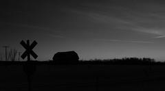 Crossing (eyesontheskies) Tags: railroad sunset bw barn crossing rr trains