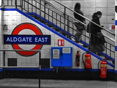 Reds & Blues (IngeniousImages) Tags: city uk travel blue red two england people urban london sign stairs underground subway metro britain transport tube steps gb urbex selectivecolour colourpop aldgateeastlondonundergroundstation