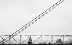 Simpler Days (relishedmonkey) Tags: nikon d5300 black white minimal minimalism monochrome lines design outside sunny architecture bridge cycle kids people young simple children students school diagonal 35mm 18g