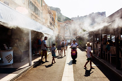 Streets of Bonifacio, Corsica (Nicola Gilg) Tags: street france bonifacio sun shadows people reportage holiday warm foggy