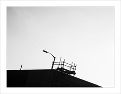 modern arboration (Howard Sandford) Tags: rooftops silhouette lamppost aitchphotosgreysky urbanlandscape scaffold cold