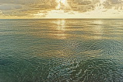 We write our memory into each other (moonbird) Tags: sea water sunrise belize caribbean garifuna centralamerica beautifulsunrise stanncreek hopkinsbelize commercebight