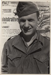 Harold Neufeld Ca Chaplains jeep driver 3-30-46 Italy note election notices on wall (lydiafairy) Tags: italy smile vintage found soldier war uniform sweet military political wwii vernacular veteran foundphoto memorialday comunista vintagephoto inuniform maninuniform haroldneufeld