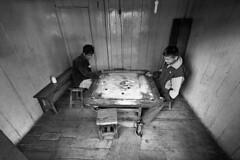 India - Darjeeling (luca marella) Tags: street people bw white black game film asia board voigtlander bessa pb bn e bianco nero carrom analogic gameboard marellaluca karrom