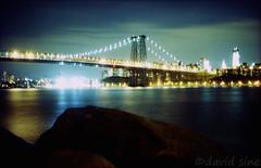 (david sine) Tags: city nyc newyorkcity longexposure bridge color film brooklyn night 35mm kodak voigtlander rangefinder eastriver blogged portra williamsburgbridge scannednegative voigtlandervitob
