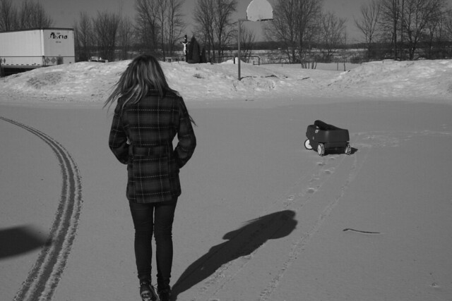 Girl walking alone in winter