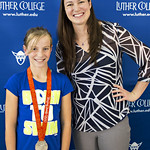 """<b>Aquatic Center Dedication of Service_100413_0208</b><br/> Photo by Zachary S. Stottler Luther College '15  Above: Christine Magnuson, two time Olympic Silver Medal winner, poses with various fans at the Luther College Service of Dedication for the new Aquatic Center.<a href=""""http://farm4.static.flickr.com/3789/10096085083_e060e64ac8_o.jpg"""" title=""""High res"""">∝</a>"""