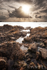 Flow Sweetly hang heavy (draken413o) Tags: travel sunset singapore asia seascapes coastal sunrays sentosa tanjung rimau yeahyeahyeahs waterscapes destinations rockscapes