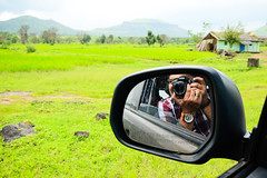into the bright green world ([s e l v i n]) Tags: camera india reflection green car photography mirror photographer village rearviewmirror greenery maharashtra igatpuri selvin ©selvin