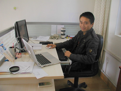 Adam Liu Song at his desk