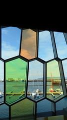 Windowcolour... (Aniemar) Tags: island islandi iceland reykjavik canon window colour fenster farben regenbogen linien lines harpa konzerthaus bunt glas art kunst boote wasser water boat colours rainbow orange gelb grün