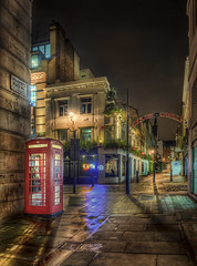 London Phonebooth at the Entrance of Carnaby (Jacob Surland) Tags: england streets london lines rain architecture night dark cityscape unitedkingdom phonebooth oldhouse carnaby portal hdr highdynamicrange oldbuilding emptystreet londonphonebooth rainystreet citybynight caughtinpixels jacobsurland