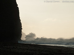 Breaking waves and cliff (David R. Crowe) Tags: light cliff usa water silhouette landscape hawaii waves places kauai coastline hi