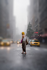 Rainy Day - Iris Blur (nicolemilligan) Tags: city nyc newyorkcity summer people woman usa ny newyork beautiful rain weather yellow lady dof taxi awesome taxis depthoffield unionsquare downpour taxicabs