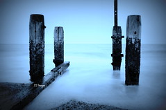 Group Of Four (EJ Images) Tags: wood uk longexposure sea england mist slr beach water coast suffolk nikon wave coastal slowshutter dslr posts groyne eastanglia lowestoft 2014 wavebreak nikonslr d90 woodenposts nikondslr pakefield groyn suffolkcoast nikond90 suffolkcoastal pakefieldbeach mistywater 18105mmlens ejimages dsc1202c5