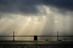 Bay Bridge (thomasdwyer) Tags: port sanfran sanfrancisco harbour ocean bridge sf california cali ca usa america westcoast bay baybridge oakland oaklandbaybridge clouds sun winter sunrays sunray architecture engineering