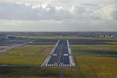 Schipol Airport runway 22 (Vee living life to the full) Tags: sky cloud clouds blue storm rain colours amsterdam netherlands holland amstel canal bridge land helicopterview birdseyeview distance marine marina fields patchwork airfield airport aeroplane carriers planes transport people network water treatment works landscape picture porthole view nikond300 2016 november holiday weekend travel tourism tourist placestovisit traveller pleasure flying flight