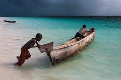 Stormy weather in Zanzibar (deborahb0cch1) Tags: children games beach childrenplay boat sailing sea seaside beachgames storm stromyweather rain clouds