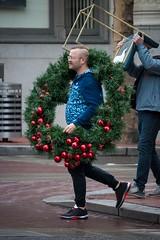Headless Bearer (RaminN) Tags: streetphotography portland street crossing red wreath bearer chair headless