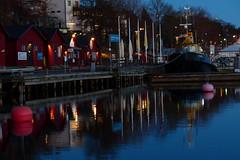 Evening in the Harbor (evisdotter) Tags: evening lights bluehour harbor hamn åssgästhamn reflections sooc västerhamn mariehamn åland buoys buoyant