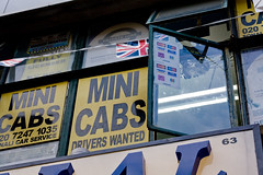 lazy cab controller (n.a.) Tags: signs brick london window lane minicabs