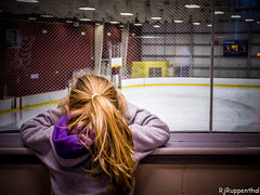 Where are the hockey players? (R J Ruppenthal) Tags: winter sports hockey girl looking empty young icerink blonde rink wherearethey lookingthrutheglass