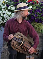 Sidmouth Hurdy-gurdy Player (Raphooey) Tags: uk england musician music southwest west festival canon eos folk south sid player international devon esplanade promenade gb week sidmouth hurdygurdy gurdy 60d hurtdy