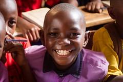 Slum Cheer (Universal Stopping Point) Tags: poverty school boy smile happy student poor uganda kampala slum bwaise