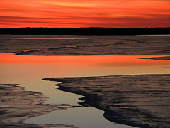 Melting Sunset (Jayhawk Explorer) Tags: sunset cold frozen lawrence melting kansas icy moaning douglascounty clintonlake creaking artisticpainting sliderssunday ipiccy vision:sunset=0858 vision:outdoor=0707 vision:clouds=0774 vision:sky=0807 vision:ocean=0651