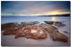 CalmRock (NikFly65) Tags: sardegna longexposure sunset sea italy cloud seascape color colour italia tramonto nuvole mare sardinia cloudy sigma wave onde alghero scogli d90 orablu bombarde portoconte nikfly