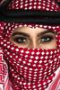 With fire in her eyes... (DesertWindsPhotography) Tags: red white black love makeup art photography green eyes eyebrows culture tradition arabia saudi qatar bahrain kuwait emirates desert عيون السعودية الكويت الإمارات الشماغ