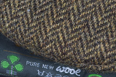 A pure classic -[ HMM ]- (Carbon Arc) Tags: macromondays clothtextile wool tweed herringbone pattern brown irish flat cap woven fabric macro cloth textile hat headcovering donegal