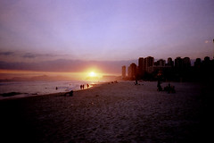 Barra da Tijuca. (Tobias Walter) Tags: city travel sunset brazil sky people urban sun travelling film beach rio clouds analog america 35mm buildings de sand janeiro sundown kodak south olympus shore da analogue 135 xa barra kb f28 tijuca ektar ektar100