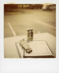 Dinner For Two (Through The Cellar Door) Tags: film austin polaroid sx70 texas 600 instant nd4 evangelinecafe roidweek2013