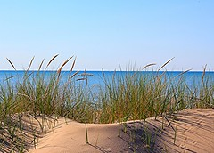 Beauty in the Bend (Judy Gayle) Tags: sky beach water reeds 50mm sand shadows bend grand