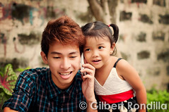Eavesdropping little girl (Gilbert Rondilla) Tags: city family friends urban male girl smile smiling female asian happy healthy dress vibrant philippines capital cellphone happiness communication listening national manila getty littlegirl filipino ponytail pinay filipina jolly talking region connectivity connection pinoy bonding gettyimages telecommunication listen eavesdropping asianethnicity gilbertrondilla gilbertrondillaphotography gettyimagescollection
