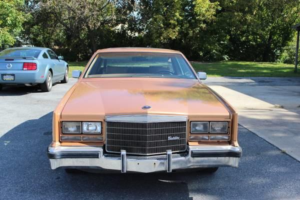 712d048130367a 1983 Cadillac Eldorado Touring Coupe (smokuspollutus) Tags  orange sonora  gm exterior body interior