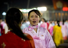 DANSEUSES AU BAL DU 15 AVRIL A PYONGYANG, COREE DU NORD (Eric Lafforgue Photography) Tags: voyage travel girls friends portrait woman color colour cute sexy girl smile smiling horizontal night happy dance asia dancers dress robe feminine femme smiles nighttime nightlight hanbok asie jolie soiree custom soir 2008 nuit fille couleur northkorea bal ideology axisofevil pyongyang eastasia feminin dprk traditionalclothing arirang juche lookingatcamera coleur festivites seduisante dictature democraticpeoplesrepublicofkorea peopleinthebackground koreanpeninsula juchesocialistrepublic coreedunord rdpc massdancing koreanethnicity insidenorthkorea lumiereartificielle eclairagedenuit joseonot