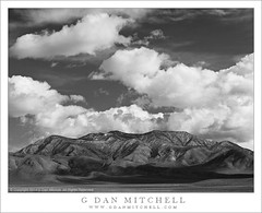 Clearing Storm, Panamint Mountains (G Dan Mitchell) Tags: park travel sky blackandwhite mountain snow storm nature monochrome clouds print landscape spring high shadows desert stock scenic national license deathvalley peaks range clearing dusted panamint