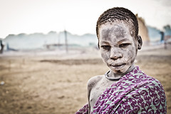 A Mundari boy dressed in traditional clothes covered in ash toward off the flies and mosquitoes. (tommcshanephotography) Tags: africa travel island war cattle cows southsudan tribe wtn crises juba rivernile cattlecamp mundari terekeka tommcshanephotography levwood levisonwood walkthenile